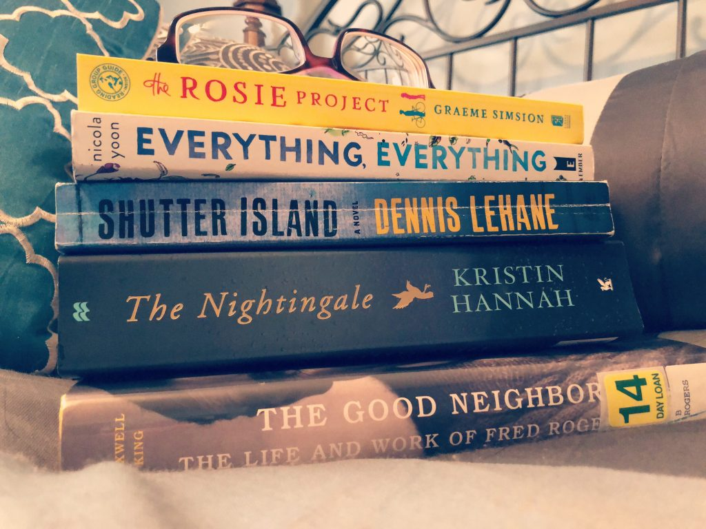 books to read in January in a stack