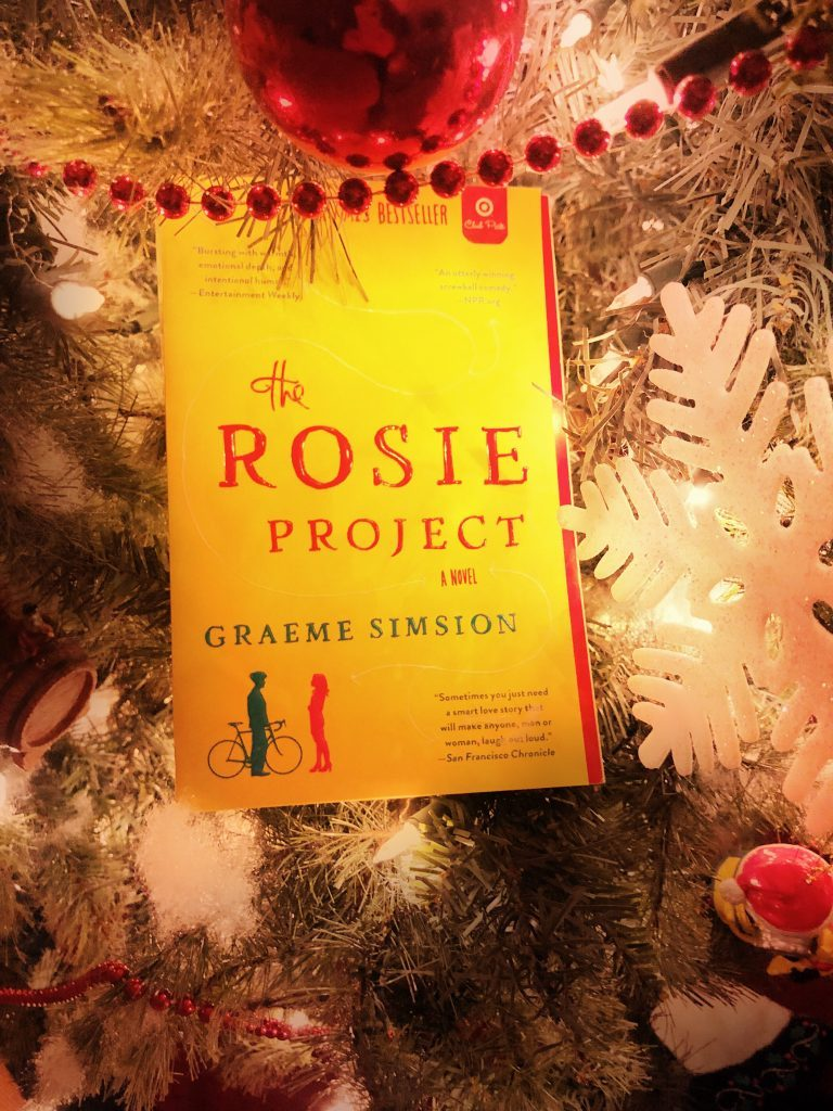 novel The Rosie Project by Graeme Simsion sitting in a Christmas tree