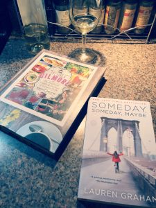 novel Someday, Someday Maybe by Lauren Graham lying on a counter with the Gilmore Girls cookbook and a glass of wine