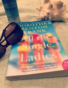 novel All the Single Ladies by Dorothea Benton Frank lying on the beach